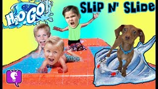 GIANT SLIP N' SLIDE with SURPRISE TOYS by the Water with HobbyKidsTV!