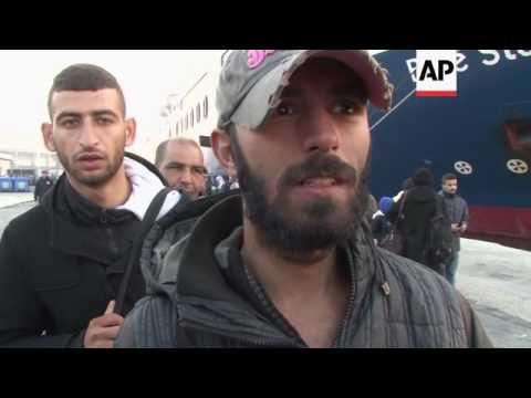 Migrants leave island as seamen end strike