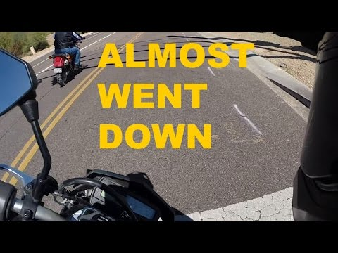 Motorcycle Almost Lowsides at Intersection