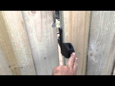 Paling fence with exposed posts and capping. Double gates and single gate part 1