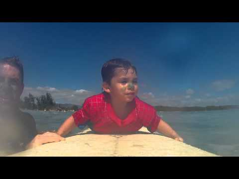 Surfing white plains beach with little man