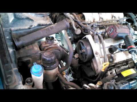 Timing belt replacement Kia Optima 2.7L  2001 - 2005 V6 water pump too  Install Remove Replace