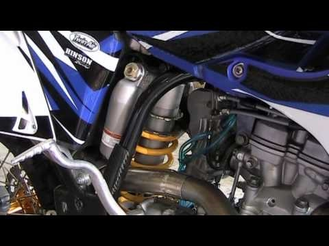 Adjust rear shock spring on MX bike with no special tools. Yamaha example.