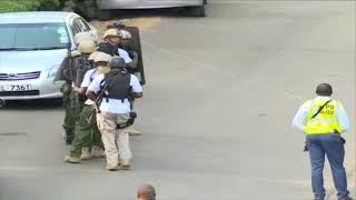 Bomb squad making their way to the site of attack at Riverside Drive