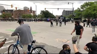 """Protestors walking into Detroit riot police at end of """"By All Means Necessary"""" march"""