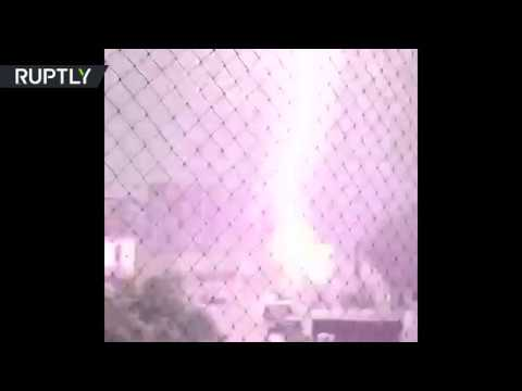 Strong lightning strike caught on cam as 'biblical' storms wreak havoc in Germany