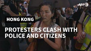 Hong Kong police make arrests as 'flashmob' protests hit pro-Beijing targets | AFP