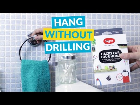 The Easiest Way to Hang Anything on Your Walls (without Using a Drill)