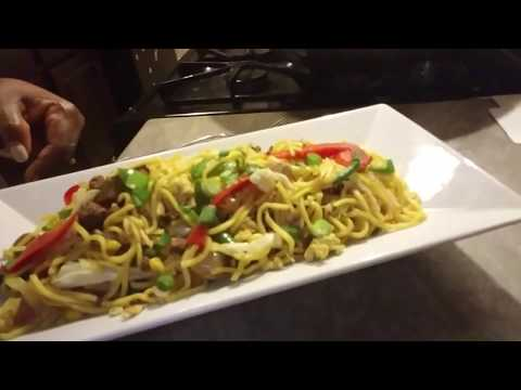Vegetable chow mein with eggs sausage and minced beef Guyanese Style