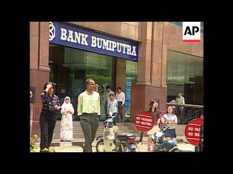 Malaysia - Central bank fixes exchange rate