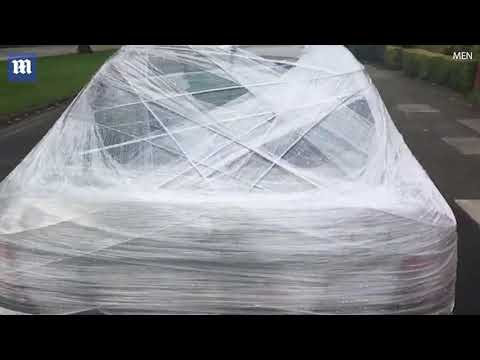 Man wraps car in stretch wrap after it's left outside his house