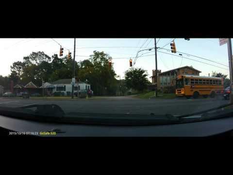 SCHOOL BUS CAUGHT ON CAMERA RUNNING RED LIGHT