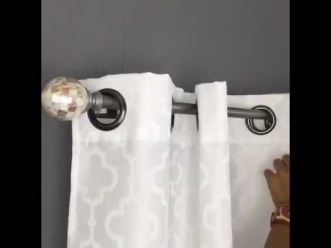 Easily hang Curtains over vertical blinds with the NoNo Bracket