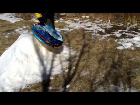 Christian sledding in backyard!