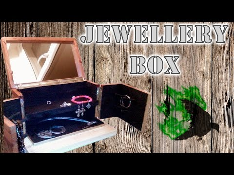 Jewellery box with inlay, mirror and flocking