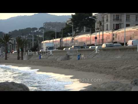 Train running along the Mediterranean Sea, Cannes