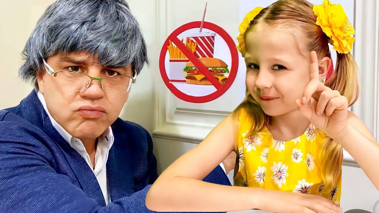 Nastya et son père font semblant de jouer à l'école