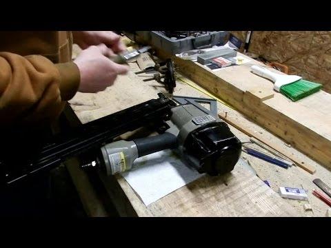 Dissecting and repairing a pneumatic nail gun.