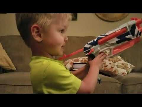 2 year old shoots T-rex with nerf gun