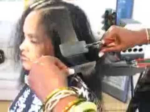 Natural Hair Straightening with the use of the Milstan Feather Flat Iron.