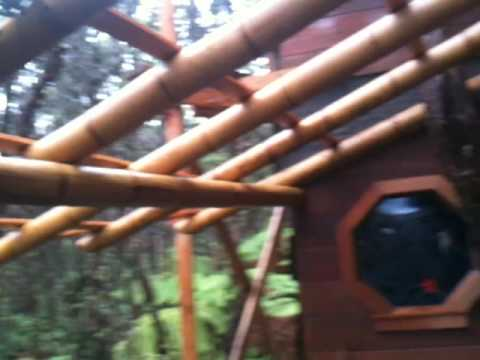 Volcano Treehouse Bamboo shed roof on first floor deck.
