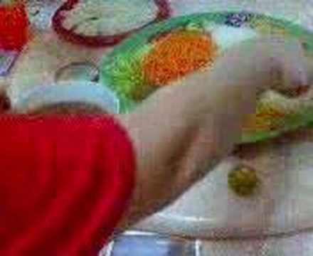 Preparing the yu sheng sauce