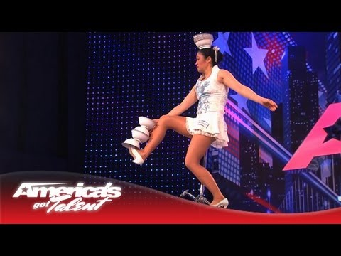 The Amazing Red Panda Tosses Bowls On Her Head While Riding a Unicycle - America's Got Talent