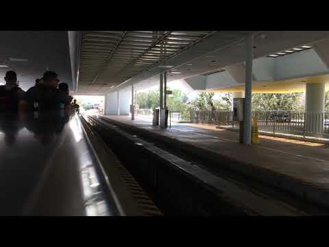Disney World monorail arriving at Epcot