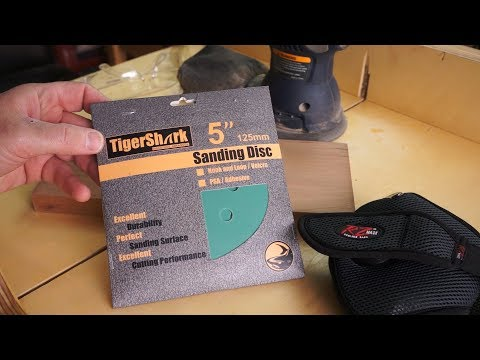 High-grit sanding cherry hardwood to a glassy surface