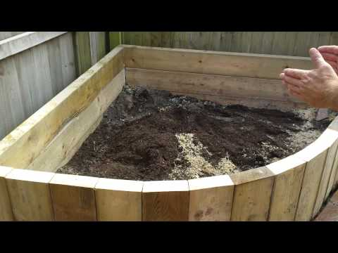 Raised Beds Using Timbers Installed In A Vertical Format