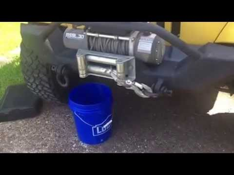 Remove and install radiator for a Jeep Wrangler TJ