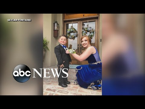 Toddler stands in for his Marine brother in prom photos