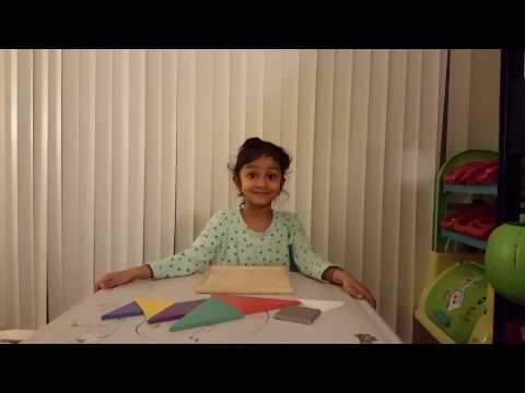 Aarisha arranging Tangram puzzle with ease!!