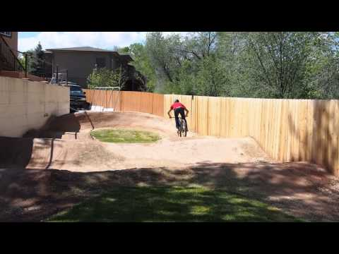 Pro Mountain Biker - Ross Schnell on his backyard pump track