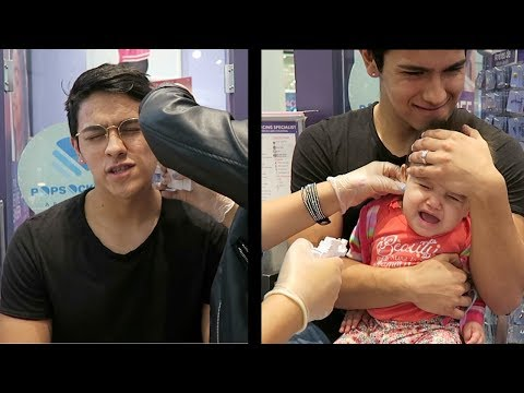 DAD GETS EARS PIERCED WITH BABY!!!