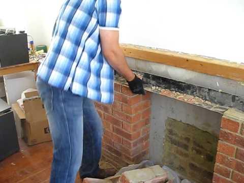 Smashing the fireplace bricks
