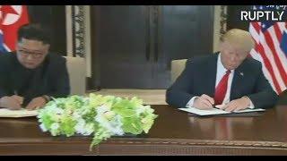 Trump & Kim sign