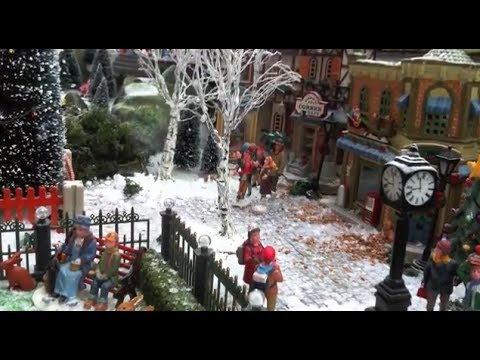 Christmas Village Displays - with Lemax houses, Department 56 models, trees, snowmen and figurines