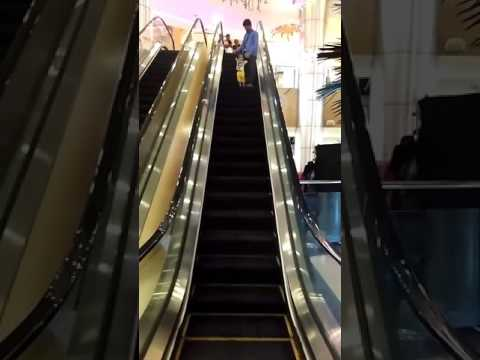 Krishiv enjoying escalator Ride
