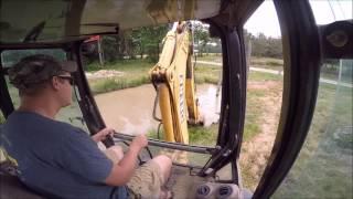 Backhoe Digging Mud