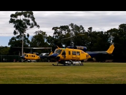 Two Bell 214B helitac's take off from Glen Forrest Oval after Perth bushfire refuel stop