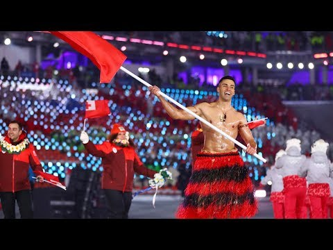 Shirtless, Oiled Flag Bearer Braves Frigid Weather For Olympics Opening Ceremony