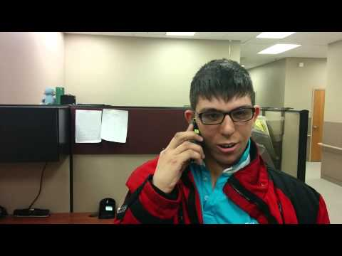 Young man with disability receives job offer over phone