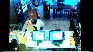 Dramatic video shows Starbucks customer fighting off armed robber