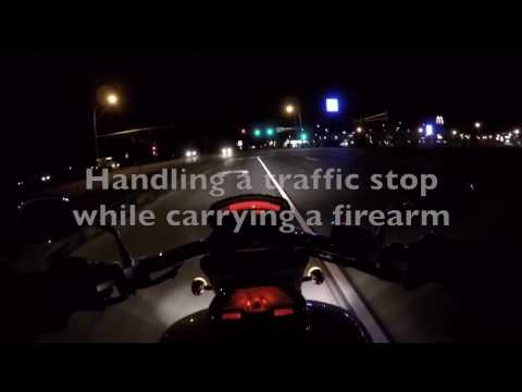 Pulled over on a motorcycle while carrying a firearm