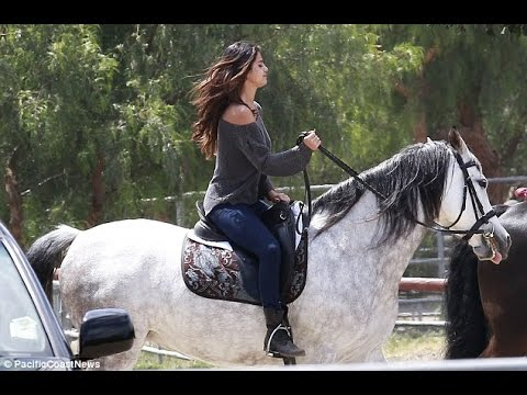 Selena's horsing around... but where's Justin? There's no sign of Bieber as Gomez saddles up