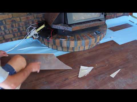 Cutting curves in timber laminate floorboards How to cut floorboards around a curved fireplace.