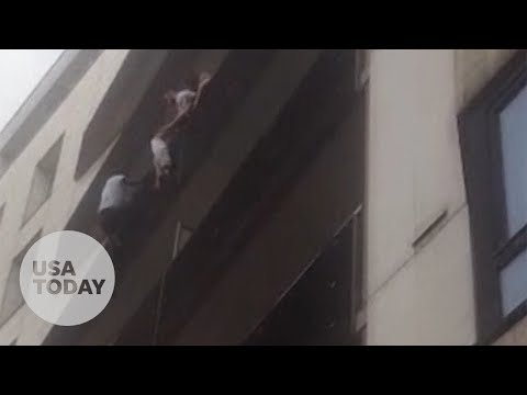 Spiderman in Paris: Migrant scales building to save child