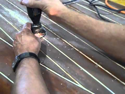 Cleaning Out Deck Seams of an Antique Wooden Boat