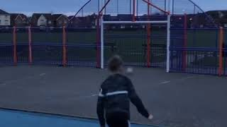 Kid Kicks Rugby Ball Straight Into Basketball Hoop - 1023090